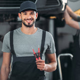 smiling mechanic holding terminal removal tool
