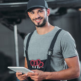 smiling mechanic holding a tablet inside a professional work garage