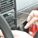 mechanic using fastener remover tool to replace car radio stereo