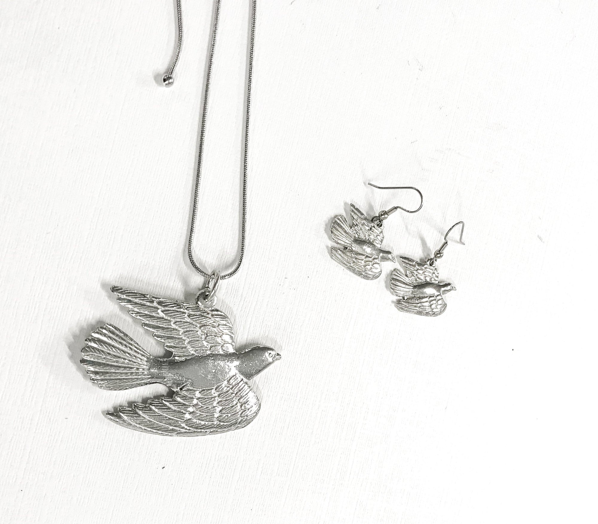 handmade pewter dove jewelry