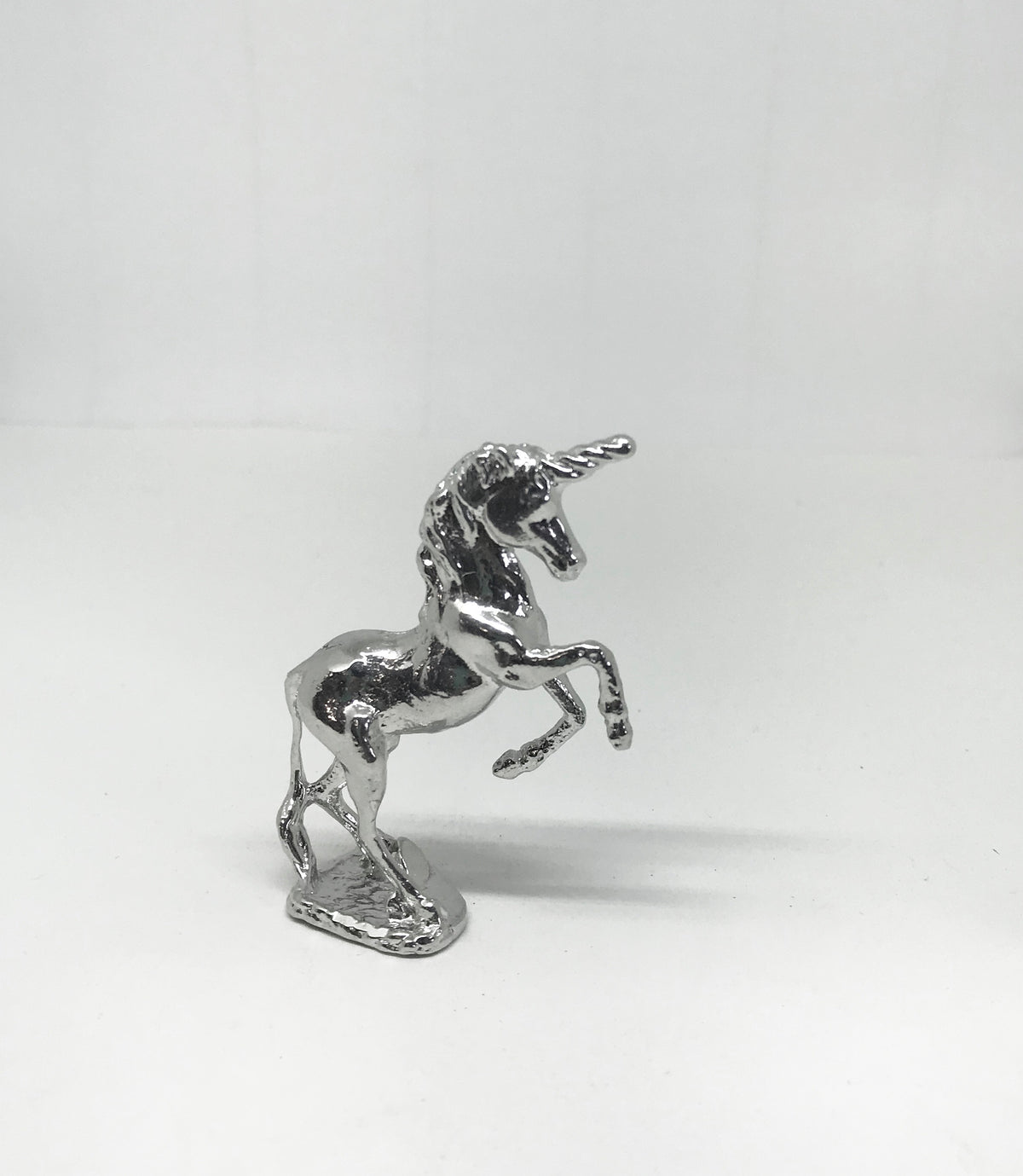silver unicorn stand up figurine