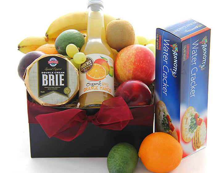 Hospital or bereavement gift basket of fresh fruit, cheese and crackers