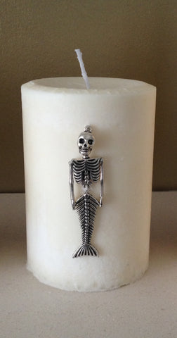 Handmade Fragranced Pillar Candle with Mermaid Skeleton Embellishment.