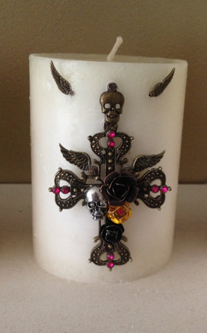 Cinnamon Fragranced Pillar Candle with Rock/Goth inspired embellishments.