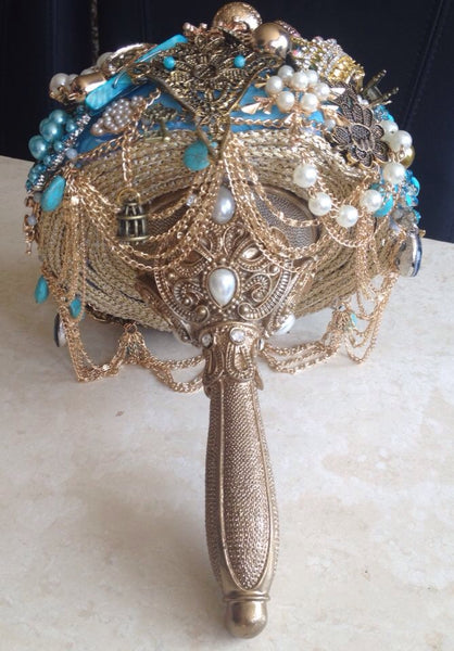 Gold and blue brooch alternative keepsake bouquet with Harry Potter inspired elements