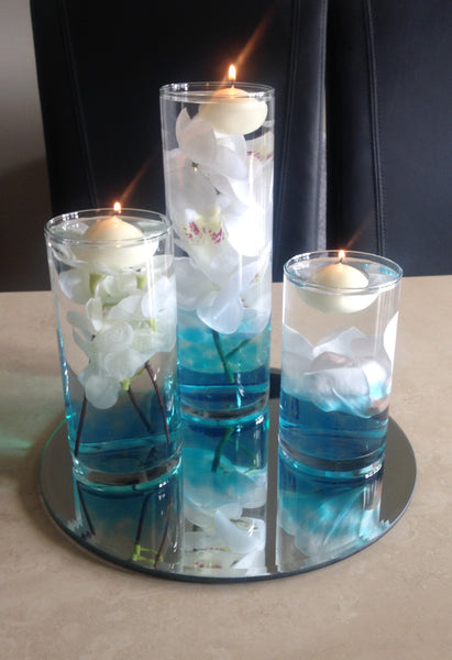 Blue lagoon silk flowers in water table centrepiece hire
