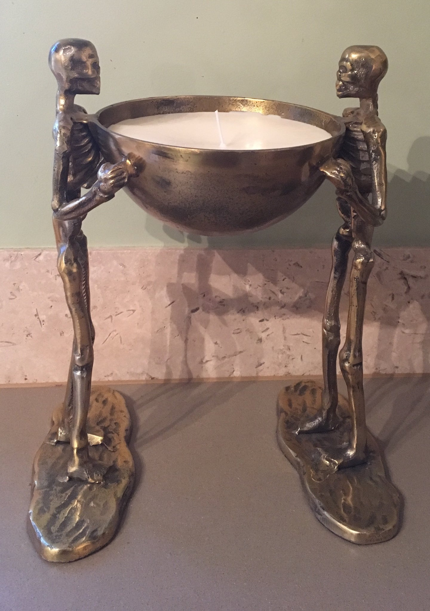 Bronze skeleton candle bowl