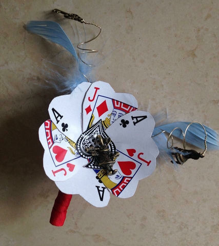 Alice in Wonderland inspired playing card alternative keepsake buttonhole
