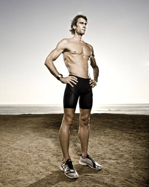 Veganuary A Guide to Going Vegan athelete Rich Roll standing on barren land in cycling shorts