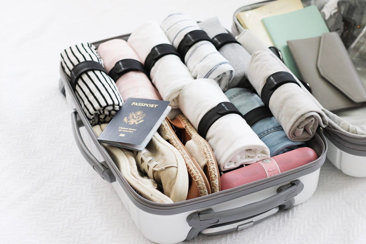 packing travel space saving organization keeping clothes unwrinkled snagged unfolded save space up to 40 percent weekend getaway Europe vacation silicone fabrics easy packing packing with kids gentle on fabrics