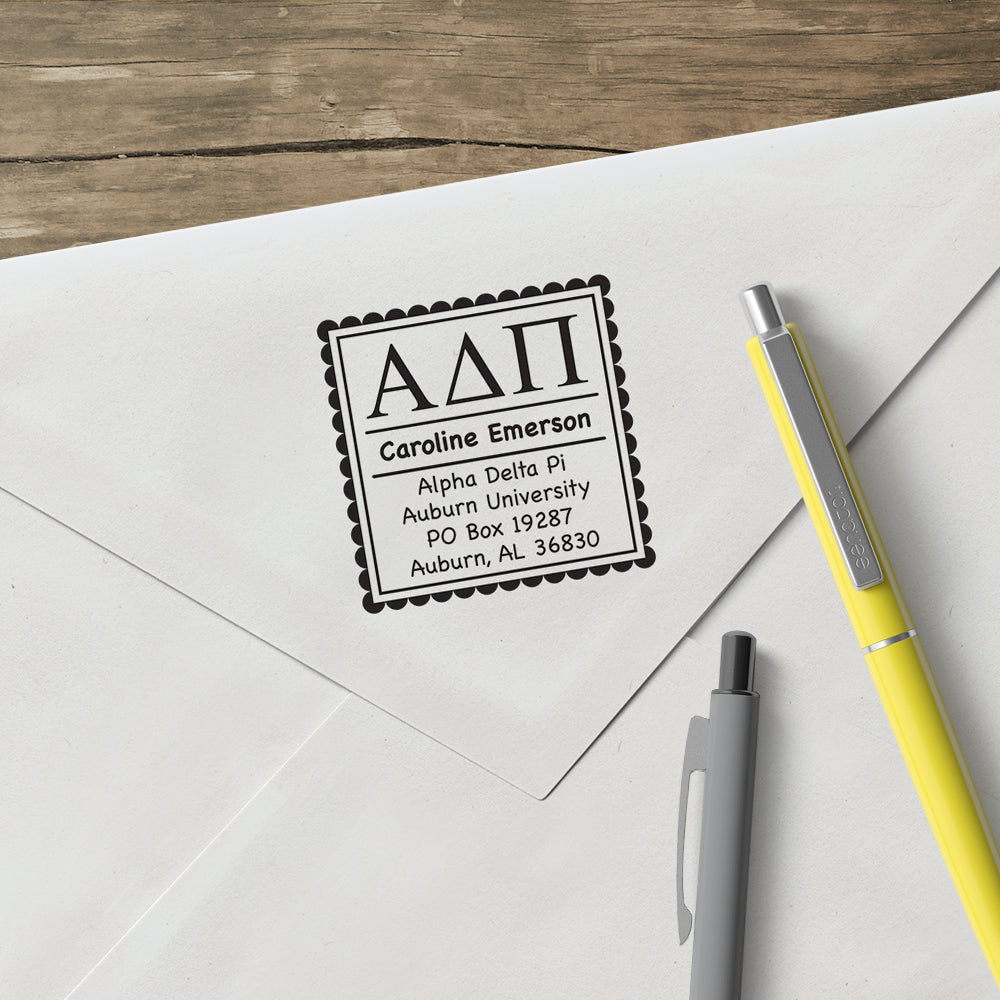 Alpha Delta Pi Address Custom Greek Stamp  Elevate your correspondence with this Designer Stamp®. Patented removable clip makes changing stamp designs clean and easy. One Stamper, Endless Possibilities®. Stamps are great for envelopes, notes, hang tags, promotional materials, and much more.  Full stamper includes device, design, and black ink (ink lasts for thousands of impressions).