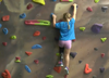 Girl with prosthetic leg from 50Legs climbing a rock wall