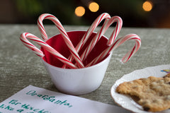 Red Kindness bowl filled with candy canes