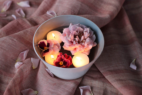 Floating candles and flowers in handblown glass bowl from Serve Kindness. Photo by @studionectar