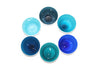 Six small handblown glass bowls in various shades of blue made in the USA from Serve Kindness