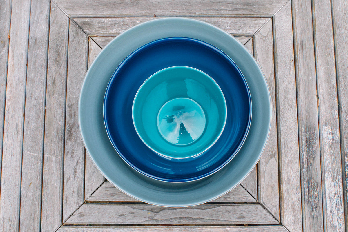 Nested set of handblown glass bowls with grey, aquamarine, and teal colors   Serve Kindness