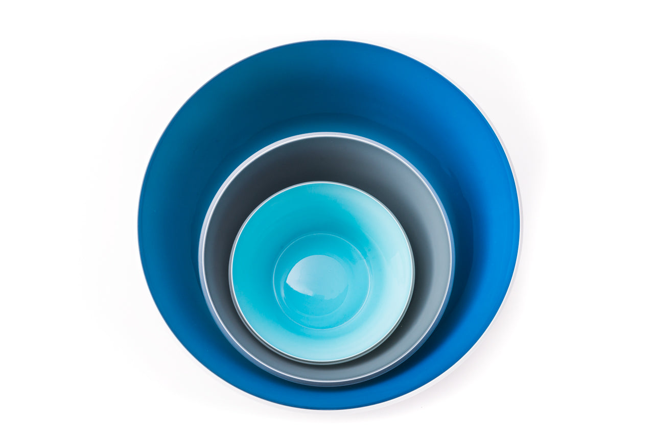 Set of nesting handblown glass bowls with an Aquamarine blue large, Dark Grey medium, and Pale Turquoise small. Made in the USA from Serve Kindness.