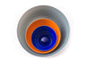 Set of nesting glass bowls with a Dark Grey large, Orange medium, and Cobalt blue small handblown glass bowls. Made in the USA from Serve Kindness.