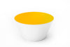 Golden yellow glass bowl handblown in the USA.