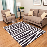 Zebra Print Rug With Black and White Stripes