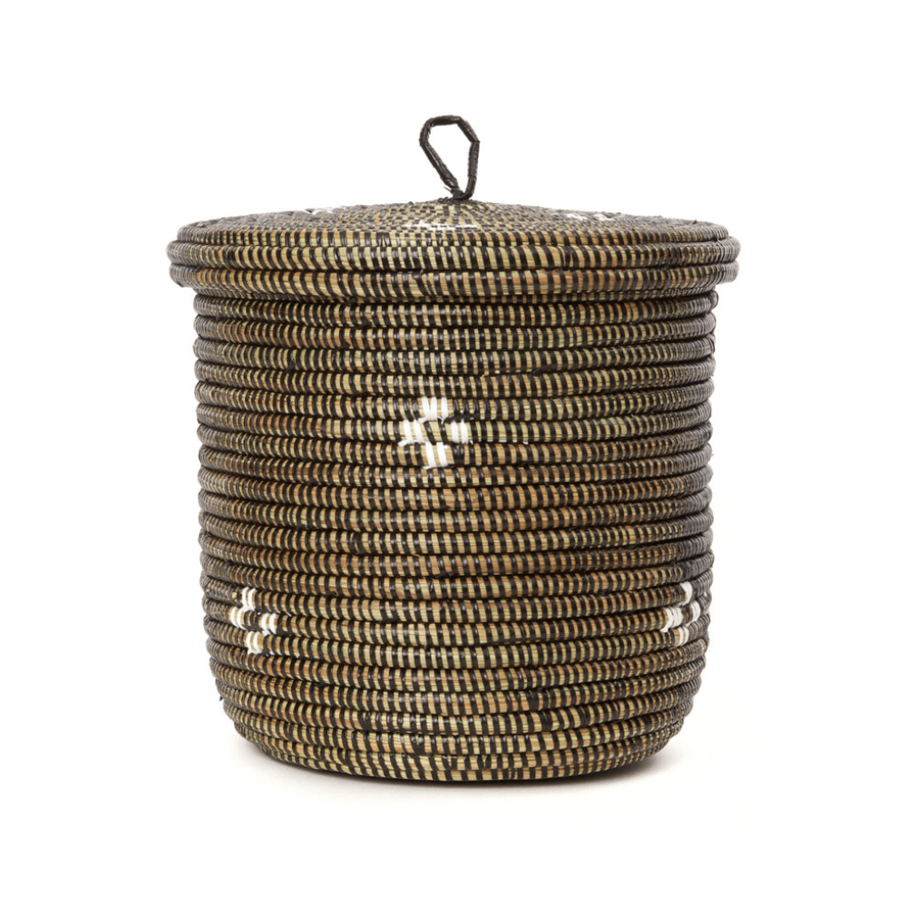 Small woven lidded storage basket in black and white pattern