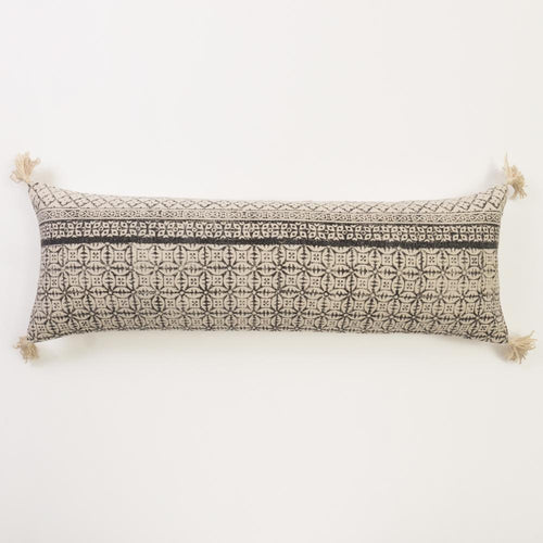 Amity Home Reed XL bolster, extra long lumber pillow for bed with black and cream block pattern and corner tassels bohemian bedding