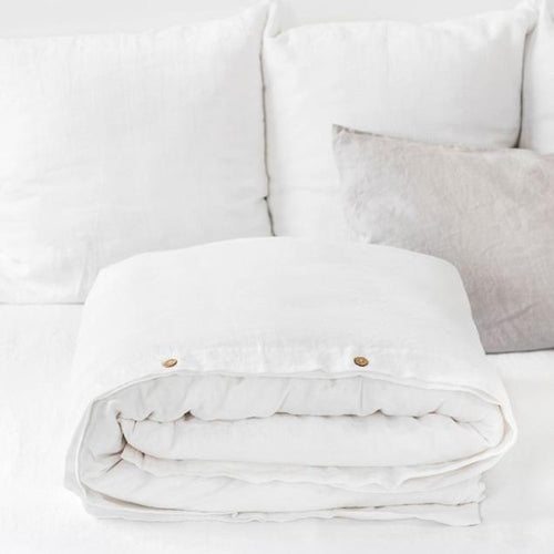white linen duvet cover with coconut wood button enclosures in queen and king sizes