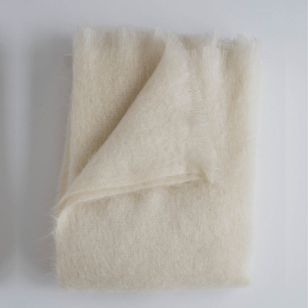 Mohair and wool pearl cream white throw blanket with fringe from Evangeline Linens UK