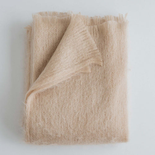 Neutral Light pink rosé mohair throw from Evangeline Linens with fringe ends