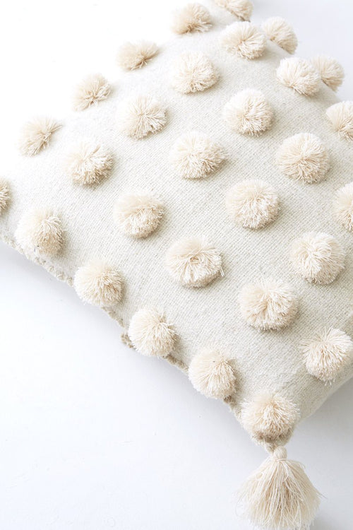 Cream color pom pom square pillow with corner tassels