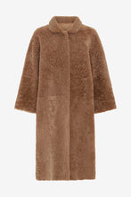Reversible shearling coat with a wide silhouette