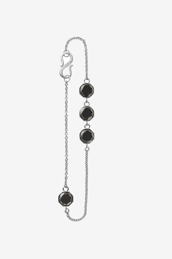 Sterling silver with four black diamonds