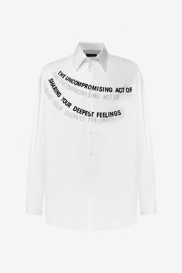 White shirt with long sleeves, classic collar and a slogan print across the chest