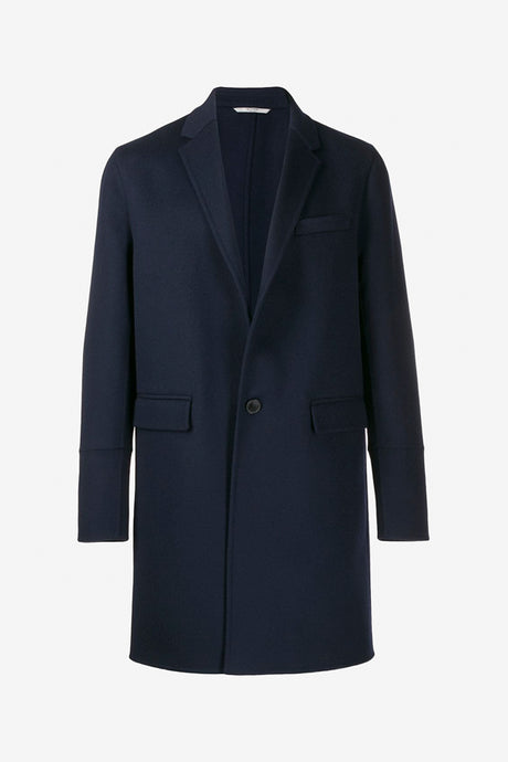 Navy colored coat with a classic silhouette and stud details on the cuffs