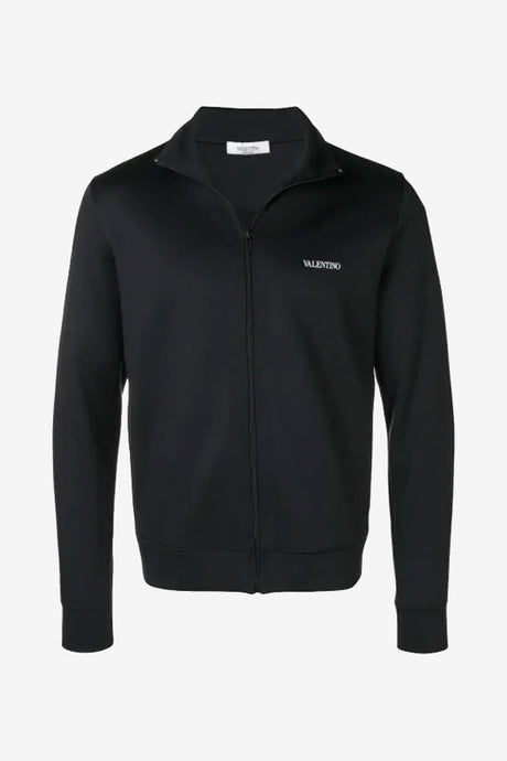 Track top in black with zip closure at the front and a white logo across the chest