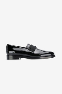 Cool black pantent loafers with elastic strap with studs