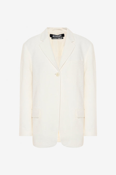 Creme colored single-breasted blazer with a boxy silhouette