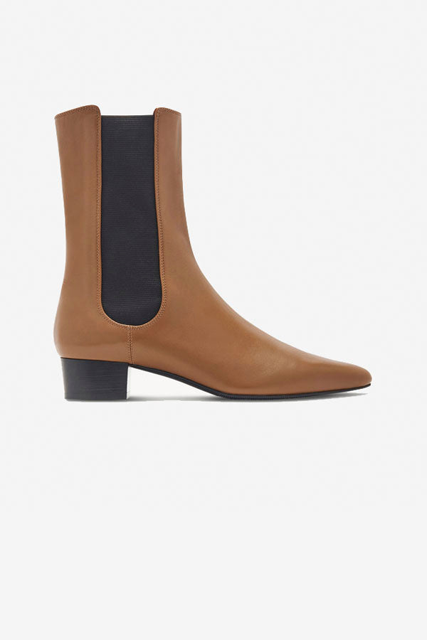 Camel boots with pointed toe and a low heel