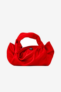 Silk knotted bag with button closure