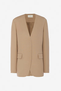 Beige colored wool jacket with long sleeves, two flap pockets, and v-shaped neck.