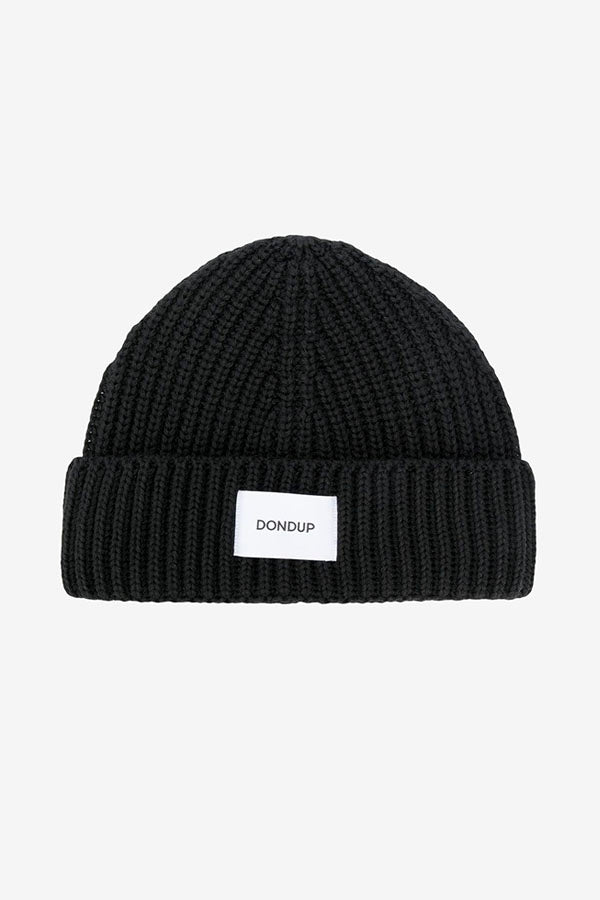 Beanie in ribbed black wool blend, with a turn up hem and patch logo in white.