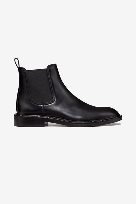 Beatle boots in black calfskin, with ruthenium stud-detailing on the welt.