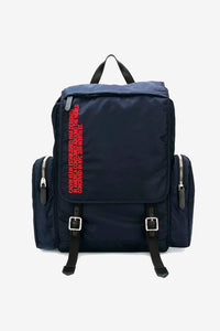 Backpack in blue nylon with red embroidment text on the front. It has top handle, adjustable shoulder straps and three pockets.