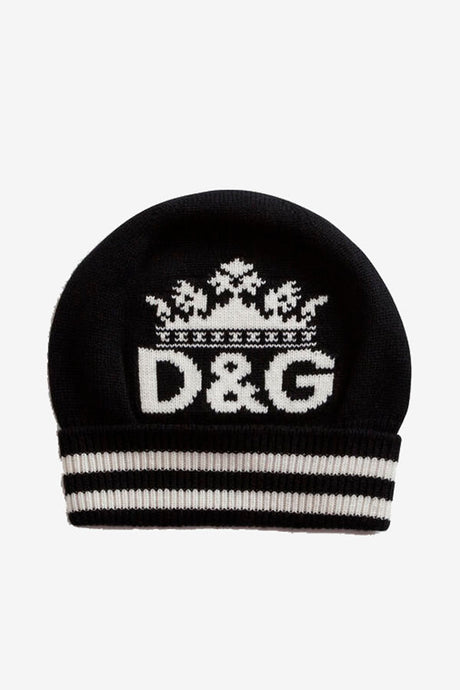 Hat knitted in soft cashmere wool. Turn-up with stripes and D&G logo and a crown knitted in white.