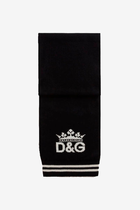 Scarf made from cashmere with different colored sides, black and white. At end of scarf is a double stripe, D&G logo and a crown in contrast color.
