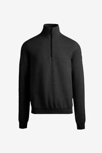 Knitwear in black merino wool and a 1/4 zipper. It is insulated in part of the interior, and has rib-knit cuffs and hem.