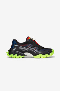 Sneaker in a combination of black, navy, burgundy made from calfskin leather and fabric. Valentino logo on side and tongue. Sole in bright green in a chunky silhouette.