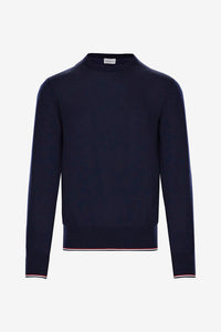 Crewneck knit in a blue cotton, with long sleeves. Tricolor striped detail in red, white and blue.