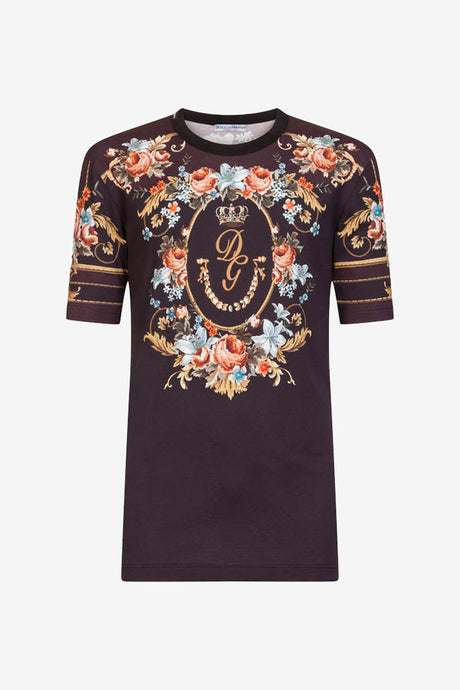 Round-neck t-shirt in black with short sleeves, a floral print on the front, back and sleeves.