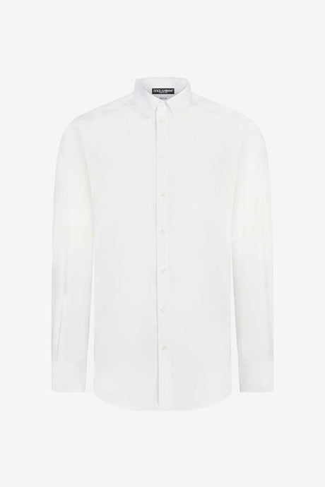 Classic white shirt, whit spread collar and pearl buttons, on back is yoke and pleat.